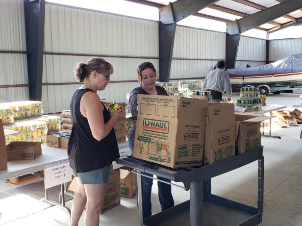 Prunuske_REO workers filling food boxes