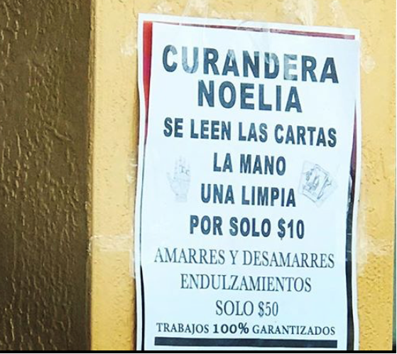 Sign in Spanish advertising a spiritual healer's services.
